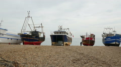 Fishing Boats beached onshore at Hastings Stock Footage