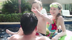 Father with children having fun in swimming pool. Stock Footage