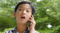Boy talking on mobile phone Arkistovideo