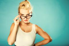 Retro pin up woman wearing eyeglasses. Stock Photos
