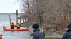 Sar-tech paddling on inflatable boat on river shore - stock footage