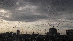 Sunset through window in the rain. 4K UHD timelapse. - stock footage