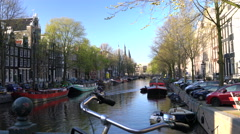 Canal, central Amsterdam, The Netherlands Stock Footage