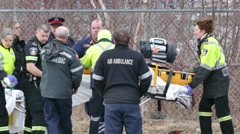 Paramedics working on unconscious victim with CPR Stock Footage