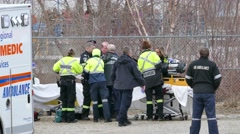 Paramedics doing CPR while standing on stretcher Arkistovideo