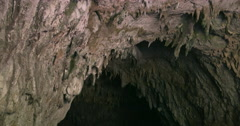 Inside cave stone wall dark light background. Cavern entrance Stock Footage