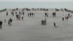 Tourists visiting the end of Hastings Pier - stock footage