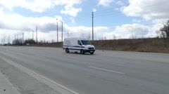 Collision reconstruction vehicle arriving at crash scene Stock Footage