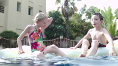 Children playing in swimming pool. Stock Footage