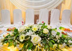 Wedding banquet table white flowers Stock Photos