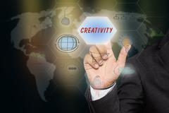"""Businessman pressing touch screen interface and select """"CREATIVITY"""". Stock Illustration"""