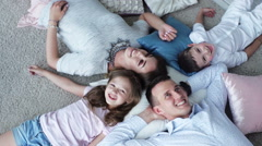 Happy family mother, father, daughter and son resting Stock Footage