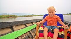 Toddler boy enjoys the boat trip Arkistovideo