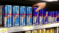 Woman buying Red Bull sugarfree energy drink inside Walmart store Stock Footage