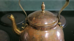 Closeup of Steam Boiling From a Copper Tea Kettle on a Stove Top Stock Footage