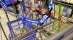 Woman buying Red Bull energy drink and putting into shopping cart - stock footage