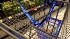 Woman buying Danone Activia yogurt and putting into shopping cart - stock footage