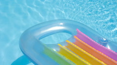 Pool Raft Floating on the Surface of a Swimming Pool Stock Footage