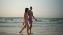 Expat couple walking at beach. Stock Footage