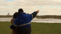 couple admires spring landscape. Russia. Siberia - stock footage