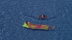 Couple enjoying in swimming pool. Stock Footage