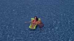Expat couple in swimming pool. Stock Footage