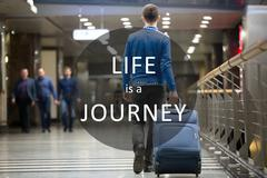 "Traveler image with motivational phrase ""Life is a Journey"" - stock photo"