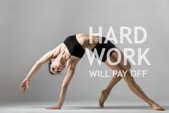 "Yogi girl exercising. Motivational text ""Hard work will pay off"" - stock photo"