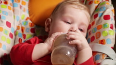 Feeding baby with bottle Stock Footage