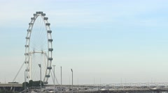 4k Singapore Flyer revealing and the Marina Bay Sands while a ship passing-Dan Stock Footage