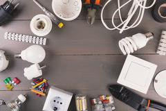 top view of electrical tools and equipment on wooden table - stock photo