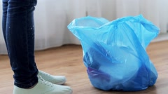 Woman tying bag with garbage at home Stock Footage