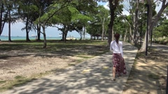 4k, Young asian woman walking along in east coast park of Singapore-Dan Stock Footage