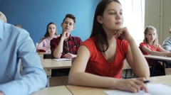 students with notebooks on lesson at school - stock footage