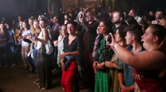 Crowd fan spectators people dancing enjoying a music concert by a stage Stock Footage