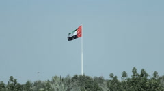 A United Arab Emirates flag flying against clean and tranquil sky. UAE Stock Footage