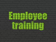 Education concept: Employee Training on wall background - stock illustration