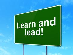 Learning concept: Learn and Lead! on road sign background Stock Illustration