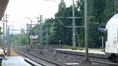 Train leaves station in Cham, Switserland Stock Footage