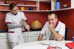 Two nurses cause a problem talk Stock Photos