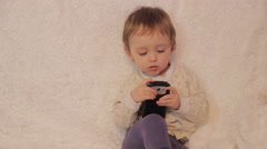 Little boy sitting on the couch and playing on a smartphone Stock Footage