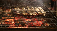 Grilled fish at Saint Antonio festival in Alfama Stock Footage