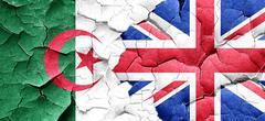 Algeria flag with Great Britain flag on a grunge cracked wall Stock Illustration