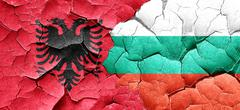 Albania flag with Bulgaria flag on a grunge cracked wall Stock Illustration