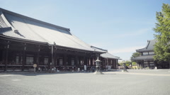 Nishi-Hongan-ji Temple in Kyoto Japan pan right to left Stock Footage