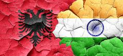 Albania flag with India flag on a grunge cracked wall - stock illustration