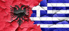 Albania flag with Greece flag on a grunge cracked wall - stock illustration