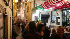 Narrow street the Saint Antonio festival in Alfama Stock Footage