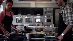 Chef cooking food at kitchen. Stock Footage