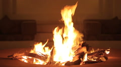 People sit at night behind a bright bonfire Stock Footage